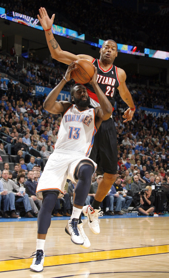 Oklahoma City\'s James Harden (13) shoots as Portland\'s Marcus Camby (23)defends during the NBA game between the Oklahoma City Thunder and the Portland Trailblazers, Sunday, March 27, 2011, at the Oklahoma City Arena. Photo by Sarah Phipps, The Oklahoman