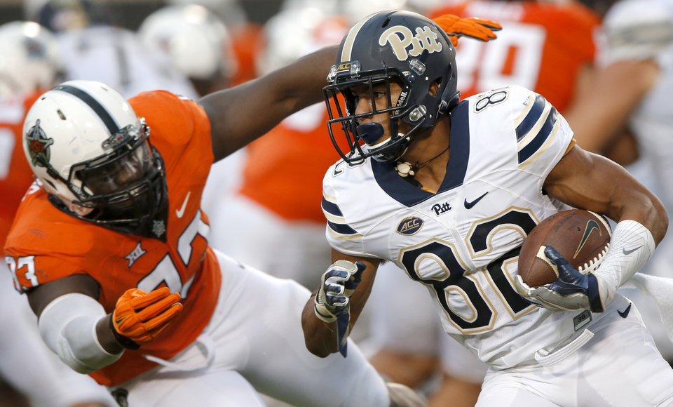 Photo - Pittsburgh's Rafael Araujo-Lopes (82) runs past Oklahoma State's Jarrell Owens (93) during a college football game between the Oklahoma State Cowboys (OSU) and the Pitt Panthers at Boone Pickens Stadium in Stillwater, Okla., Saturday, Sept. 17, 2016. Photo by Chris Landsberger, The Oklahoman