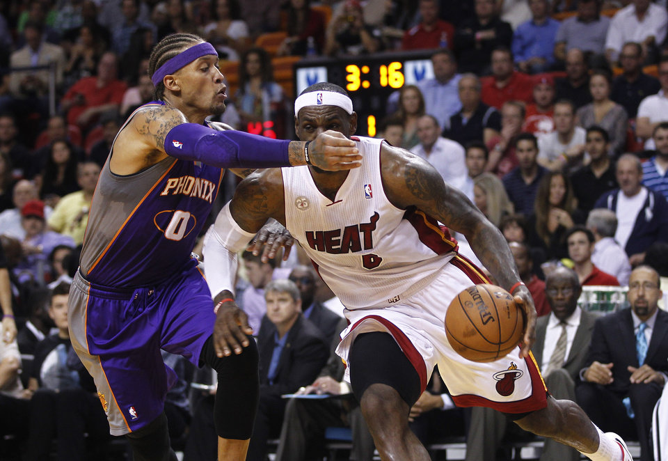 Phoenix Suns' Michael Bealsey (0) tries to block Miami Heat's LeBron James (6) during the first half of an NBA basketball game in Miami, Monday, Nov. 5, 2012. (AP Photo/J Pat Carter)