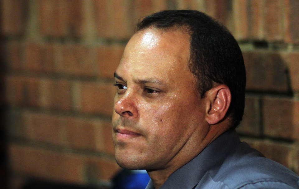 FILE- In this Wednesday, Feb. 20, 2013 file photo, Investigating officer Hilton Botha, sits inside the court witness box during the Oscar Pistorius bail hearing at the magistrate court in Pretoria, South Africa. The lead investigator in the murder case against Oscar Pistorius faces attempted murder charges himself over a 2011 shooting, police said Thursday, Feb. 21, 2013,  in another potentially damaging blow to the prosecution. Prosecutors said they were unaware of the charges against veteran detective Hilton Botha when they put him on the stand in court to explain why Pistorius should not be given bail in the Valentine's Day shooting death of his girlfriend.  Police Brig. Neville Malila told The Associated Press that Botha � who gave testimony in the Pistorius bail hearing on Wednesday � is scheduled to appear in court in May on seven counts of attempted murder related to an incident in October 2011 when Botha and two other police officers fired at a minibus they were trying to stop. (AP Photo/Themba Hadebe, File)