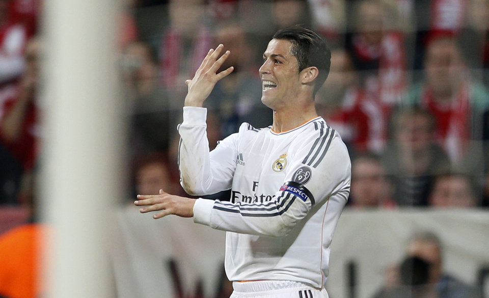 Photo - Real's Cristiano Ronaldo celebrates scoring his side's 3rd goal during the Champions League semifinal second leg soccer match between Bayern Munich and Real Madrid at the Allianz Arena in Munich, southern Germany, Tuesday, April 29, 2014. (AP Photo/Matthias Schrader)