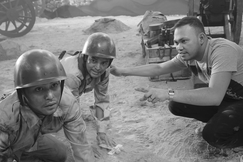 In this undated photo released by Forward Entertainment, Filipino director Borinaga Alix Jr., right, instructs actors on the set of his film