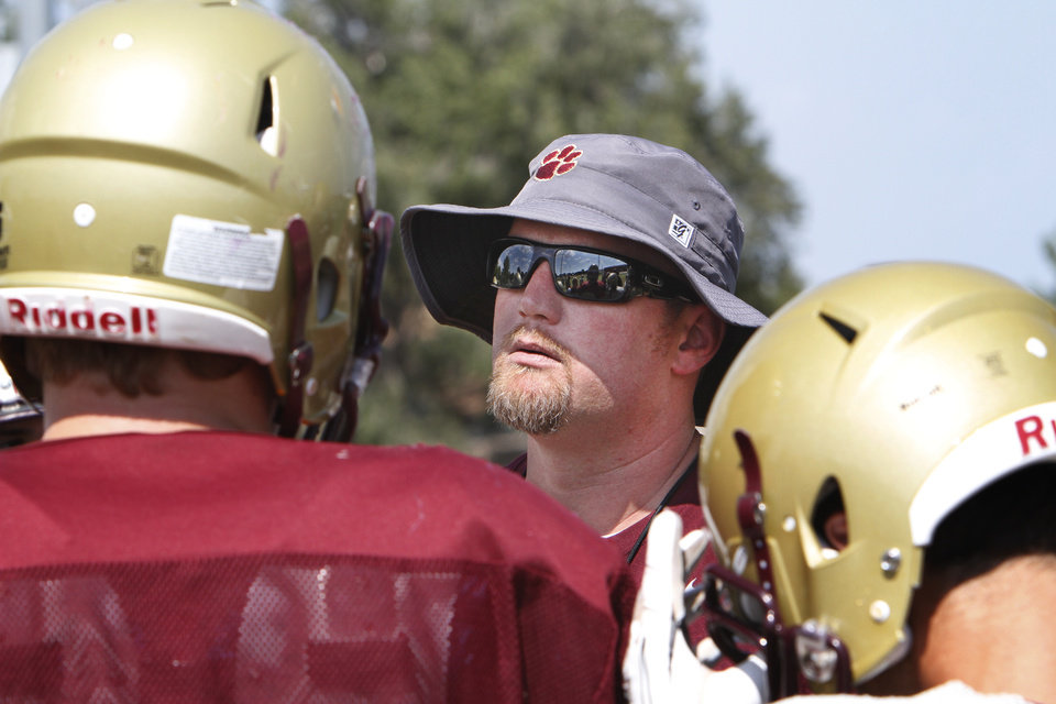 Photo - Coach Lynn Shackelford at Cashion's football practice, Monday, August 18, 2014. Photo by David McDaniel, The Oklahoman