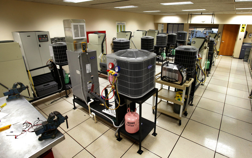 Photo - Students are trained on fixing air conditioning units in this classroom of the center in Norman.