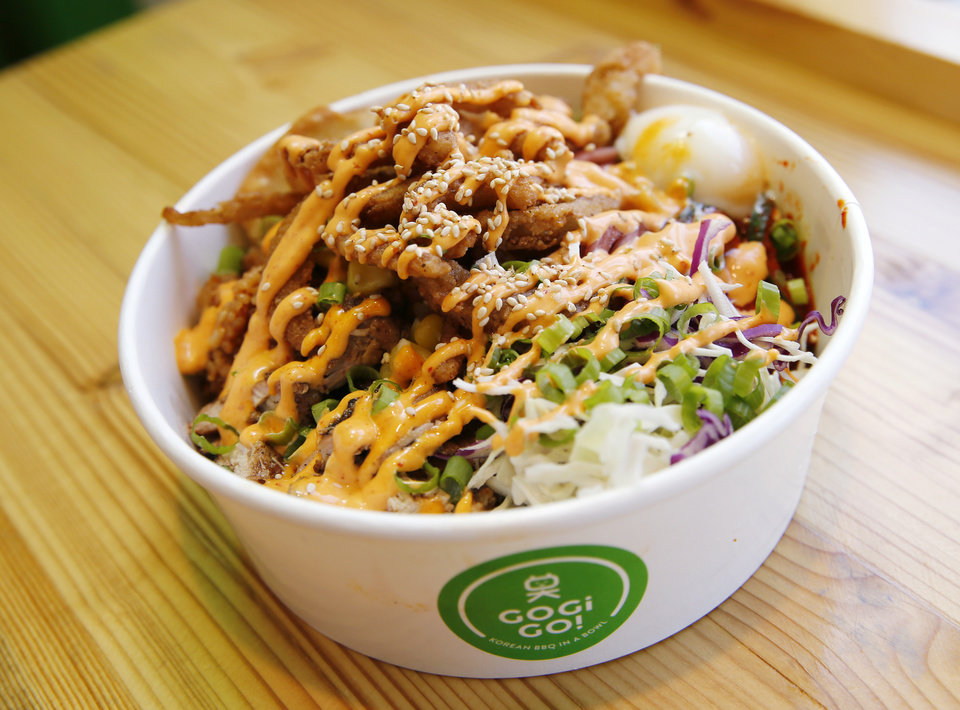 Photo -  A spicy chicken bowl at Gogi Go. [Photo by Nate Billings, The Oklahoman]