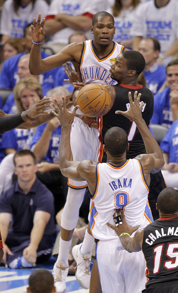 Photo - Oklahoma City's Kevin Durant (35) passes the ball over Miami's Chris Bosh (1) to Serge Ibaka (9) during Game 2 of the NBA Finals between the Oklahoma City Thunder and the Miami Heat at Chesapeake Energy Arena in Oklahoma City, Thursday, June 14, 2012. Photo by Chris Landsberger, The Oklahoman