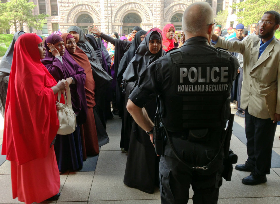 Photo - Supporters of two Somali women scheduled to be sentenced for helping a terrorist group gather outside the Hennepin County Government Center on Thursday, May 16, 2013, in Minneapolis.   The two women being sentenced went door-to-door in the name of charity to collect money for the terror group al-Shabab in Somalia.  (AP Photo/The Star Tribune, )  MANDATORY CREDIT; ST. PAUL PIONEER PRESS OUT; MAGS OUT; TWIN CITIES TV OUT