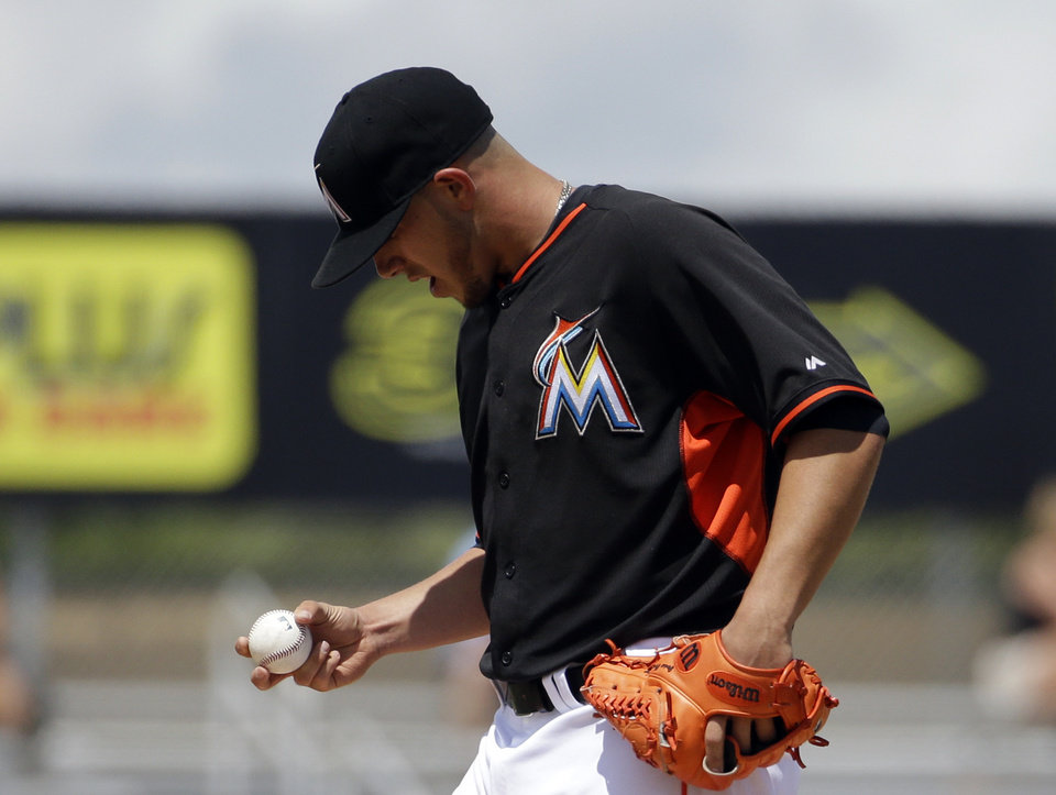 Photo - Miami Marlins starting pitcher Jose Fernandez looks at the ball during the third inning of an exhibition spring training baseball game against the St. Louis Cardinals, Tuesday, March 25, 2014, in Jupiter, Fla. (AP Photo/David Goldman)