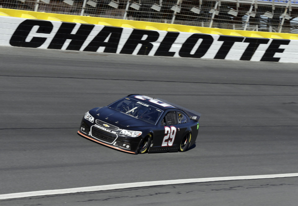 Photo - Austin Dillon drives his car out of Turn 4 during NASCAR Sprint Cup testing for the 2014 season at Charlotte Motor Speedway in Concord, N.C., Wednesday, Dec. 11, 2013. (AP Photo/Chuck Burton)
