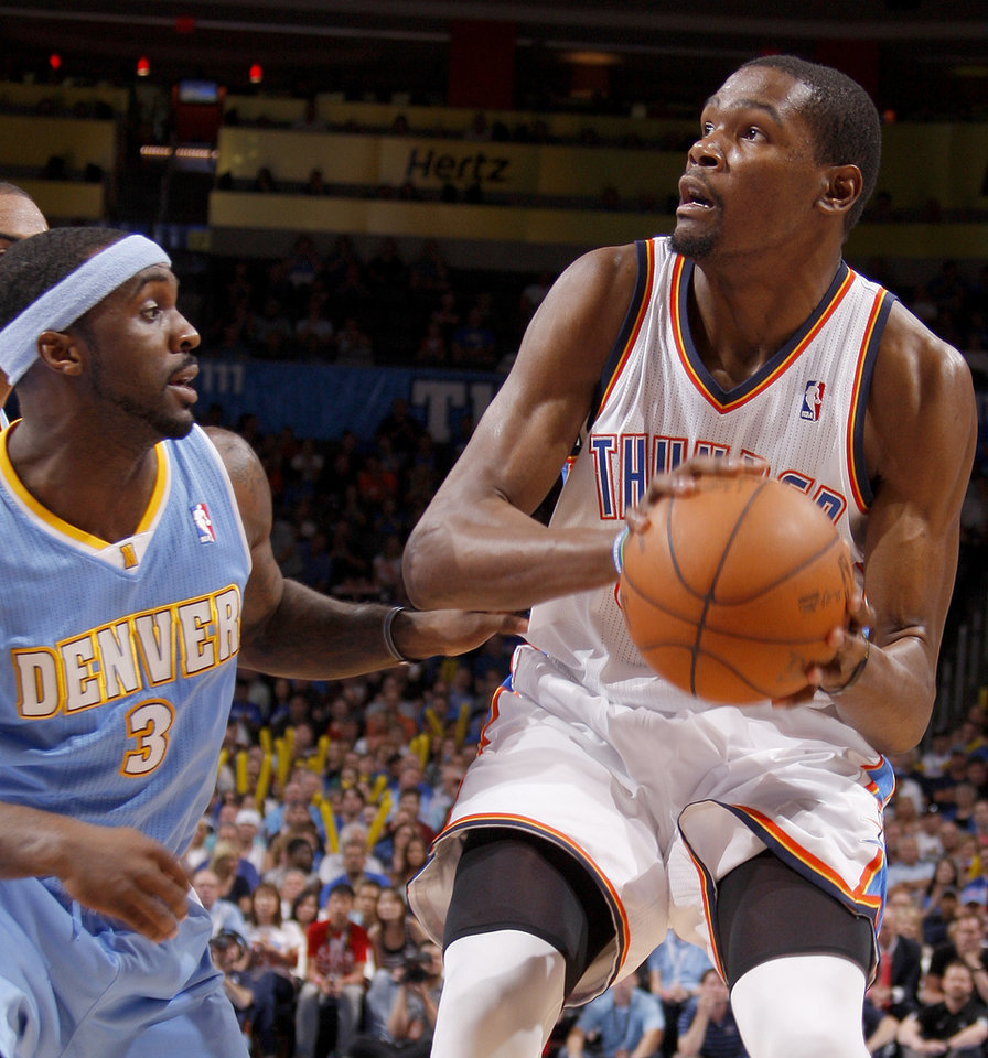 /tok35n/ looks to shoot beside Denver\'s Ty Lawson (3) during the NBA basketball game between the Oklahoma City Thunder and the Denver Nuggets at Chesapeake Energy Arena in Oklahoma City, Wednesday, April 25, 2012. Oklahoma City lost 106-101. Photo by Bryan Terry, The Oklahoman