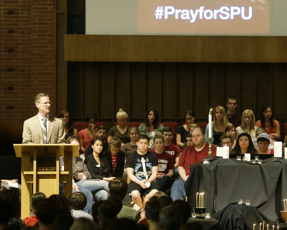 Photo - Dan Martin, left, President of Seattle Pacific University, speaks at a prayer service at the First Free Methodist Church Thursday, June 5, 2014 at Seattle Pacific University in Seattle, where a shooting took place Thursday afternoon.(AP Photo/Ted S. Warren)