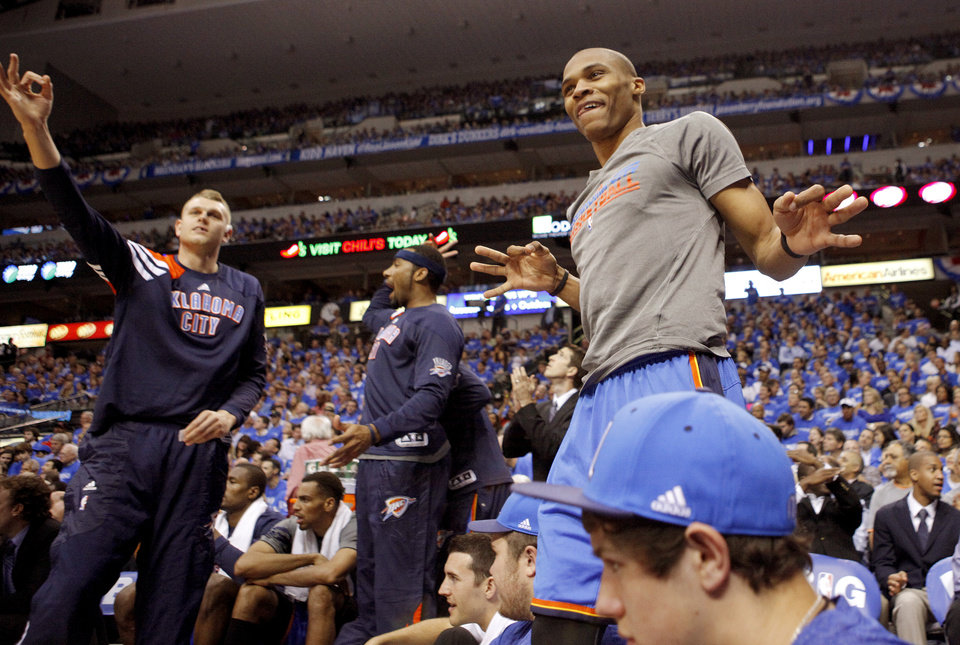 Photo - Oklahoma City's Russell Westbrook, at right, and Cole Aldrich celebrate during Game 3 of the first round in the NBA playoffs between the Oklahoma City Thunder and the Dallas Mavericks at American Airlines Center in Dallas, Thursday, May 3, 2012. Oklahoma City won 95-79. Oklahoma City won 95-79. Photo by Bryan Terry, The Oklahoman