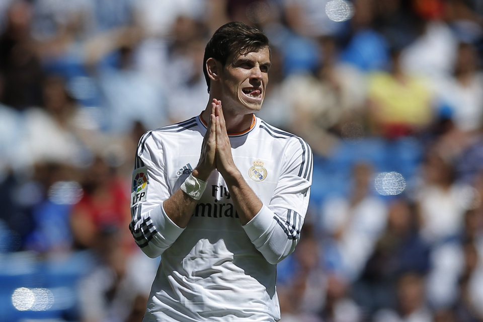 Photo - Real Madrid's Gareth Bale from Wales gestures during a Spanish La Liga soccer match between Real Madrid and Espanyol at the Santiago Bernabeu stadium in Madrid, Spain, Saturday, May 17, 2014 . (AP Photo/Daniel Ochoa de Olza)