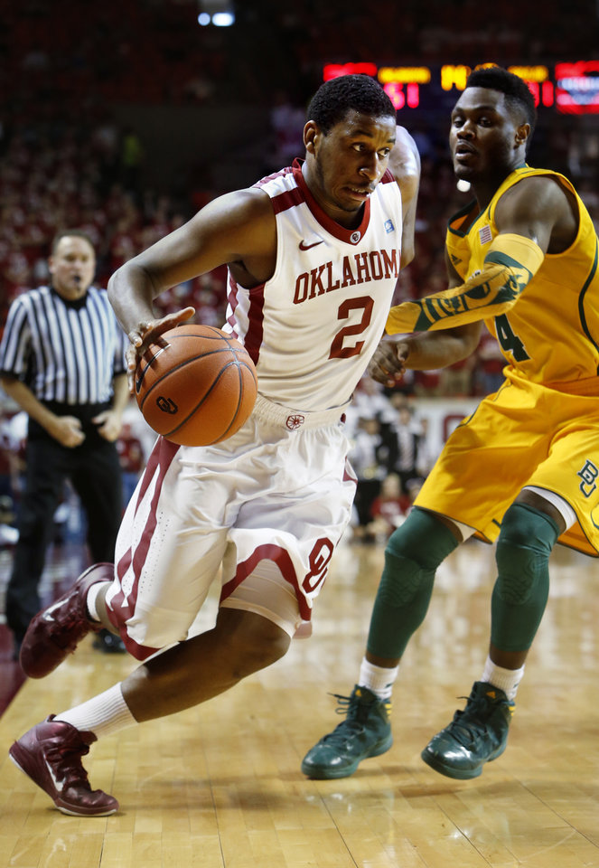 Photo - Oklahoma Sooner's Steven Pledger (2) goes around Baylor Bear's Gary Franklin (4) in the second half as the University of Oklahoma Sooners (OU) men defeat the Baylor University Bears (BU) 90-76 in NCAA, college basketball at The Lloyd Noble Center on Saturday, Feb. 23, 2013  in Norman, Okla. Photo by Steve Sisney, The Oklahoman