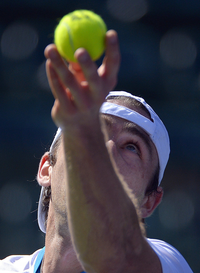 Photo - Benjamin Becker, of Germany, serves against Edouard Roger-Vasselin, of France, during a first round match at the BNP Paribas Open tennis tournament, Thursday, March 6, 2014, in Indian Wells, Calif. (AP Photo/Mark J. Terrill)