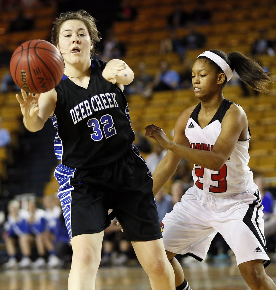 Photo - Deer Creek's Bayli Blanchard (32) passes away from East Central's Delaysha McCall (23) during the Class 5A girls championship game in the state high school basketball tournament between Deer Creek and Tulsa East Central at the Mabee Center in Tulsa, Okla., Saturday, March 15, 2014. Photo by Nate Billings, The Oklahoman