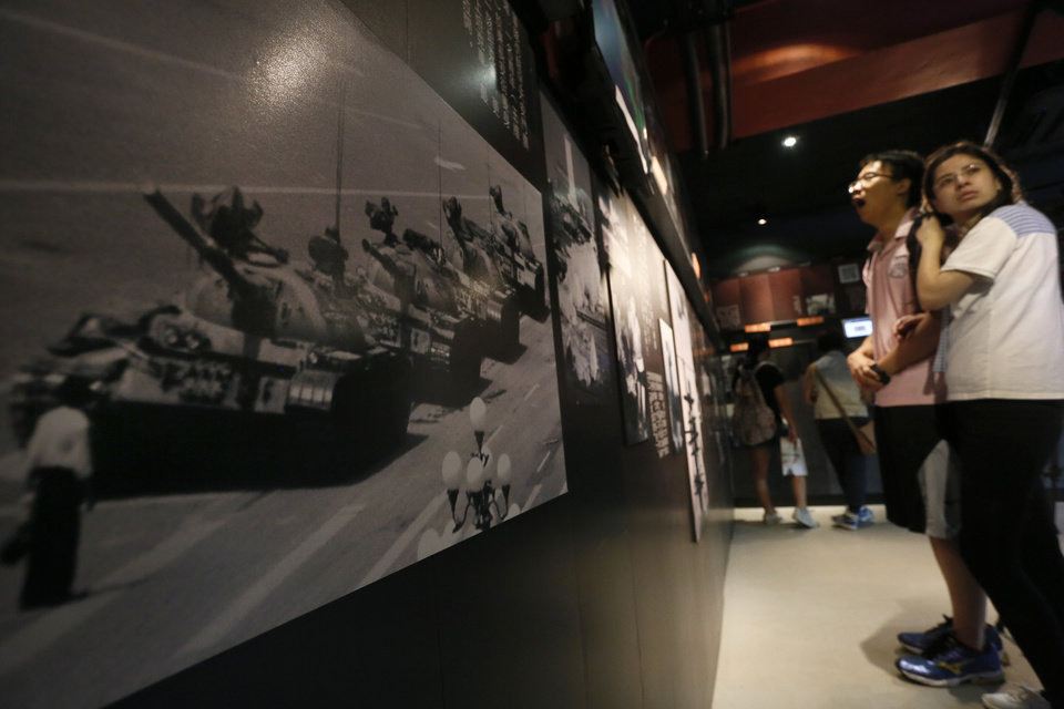 Photo - In this May 28, 2014 photo, a photograph of Tank Man, the lone protester who stood to block the way of a line of several tanks during the 1989 pro-democracy movement in Beijing,  is displayed at the June 4th Museum in Hong Kong. The 75 square meters (800 square feet) June 4th Museum is the world's only museum chronicling the brutal crackdown on the 1989 Tiananmen protests. (AP Photo/Vincent Yu)