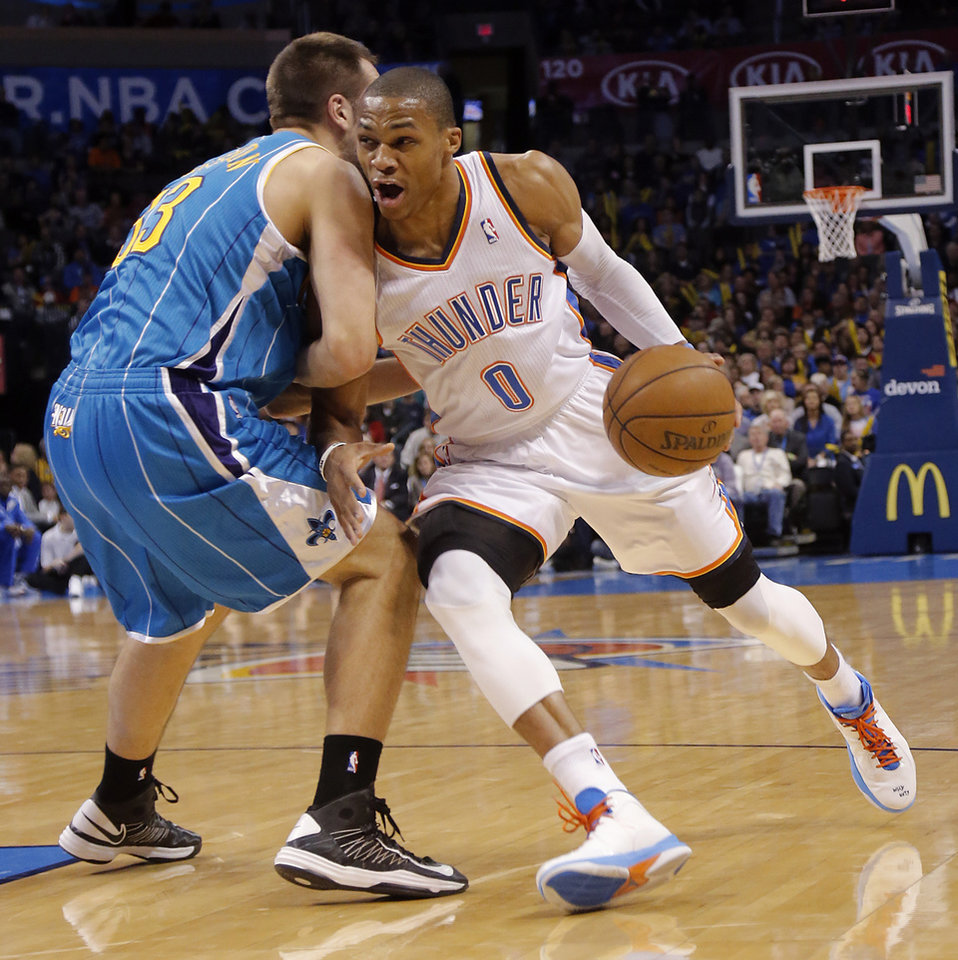 Oklahoma City Thunder's Russell Westbrook (0) drives against New Orleans Hornets' Ryan Anderson (33) during the NBA basketball game between the Oklahoma City Thunder and the New Orleans Hornets at the Chesapeake Energy Arena on Wednesday, Feb. 27, 2013, in Oklahoma City, Okla. Photo by Chris Landsberger, The Oklahoman