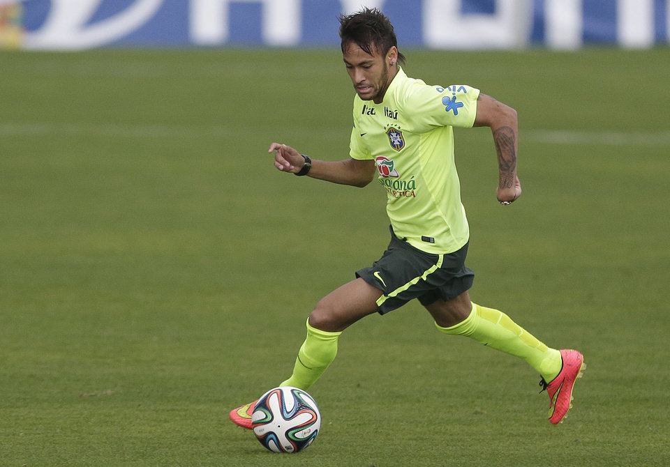 Photo - Brazil's Neymar practices during a training session of Brazil at the Granja Comary training center in Teresopolis, Brazil, Monday, June 9, 2014. Brazil play in group A of the 2014 soccer World Cup. (AP Photo/Andre Penner)