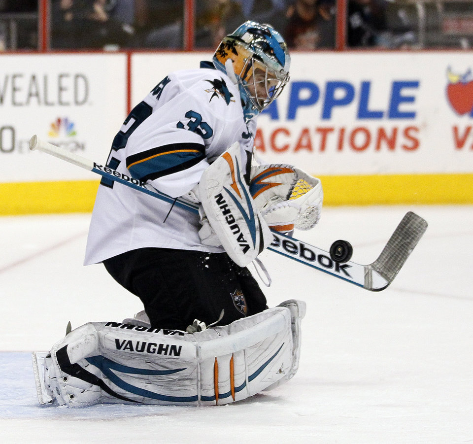 Photo - San Jose Sharks' Alex Stalock deflects a shot with his stick during the second period of an NHL hockey game against the Philadelphia Flyers, Thursday, Feb. 27, 2014, in Philadelphia. The Sharks won 7-3. (AP Photo/Tom Mihalek)