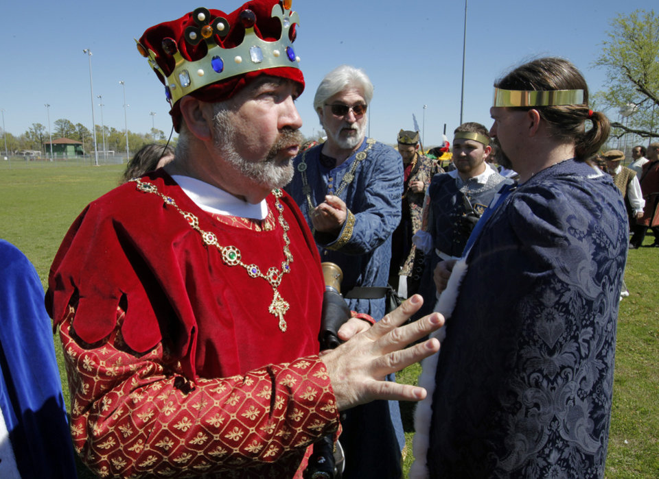 Cody Clark, talks with other costumed performers at a rehearsal for the Medieval Fair in Norman.  PHOTOS BY STEVE SISNEY, THE OKLAHOMAN