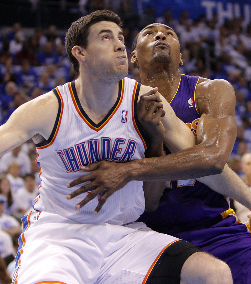 Photo - LOS ANGELES LAKERS / NBA BASKETBALL: Oklahoma City's Nick Collison battles with Los Angeles' Metta World Peace during Game 2 in the second round of the NBA playoffs between the Oklahoma City Thunder and the L.A. Lakers at Chesapeake Energy Arena on Wednesday,  May 16, 2012, in Oklahoma City, Oklahoma. Photo by Chris Landsberger, The Oklahoman