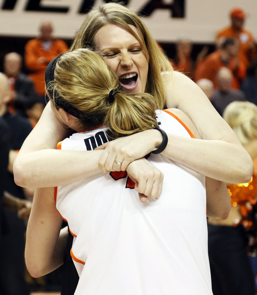 Photo - Graduate assistant and former OSU basketball player Megan Byford hugs Liz Donohoe (4) after the Bedlam women's college basketball game between Oklahoma State University and the University of Oklahoma at Gallagher-Iba Arena in Stillwater, Okla., Saturday, Feb. 23, 2013. OSU beat OU, 83-62. Photo by Nate Billings, The Oklahoman