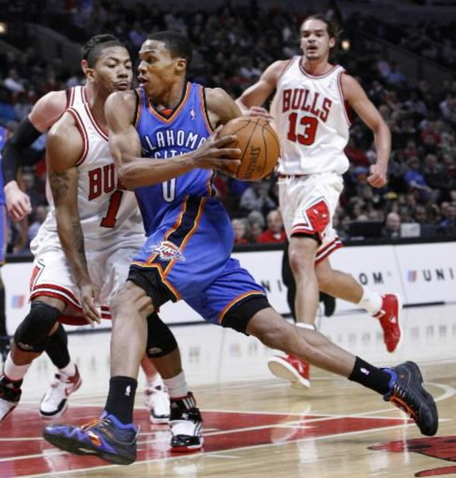 Derrick Rose (left) might be running away with the MVP award. But some think Russell Westbrook is just as, if not more, worthy.
