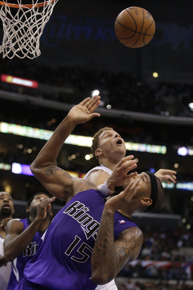 Los Angeles Clippers forward Blake Griffin, top, battles Sacramento Kings center DeMarcus Cousins for a rebound during the first half of an NBA basketball game in Los Angeles, Friday, Dec. 21, 2012. (AP Photo/Chris Carlson)