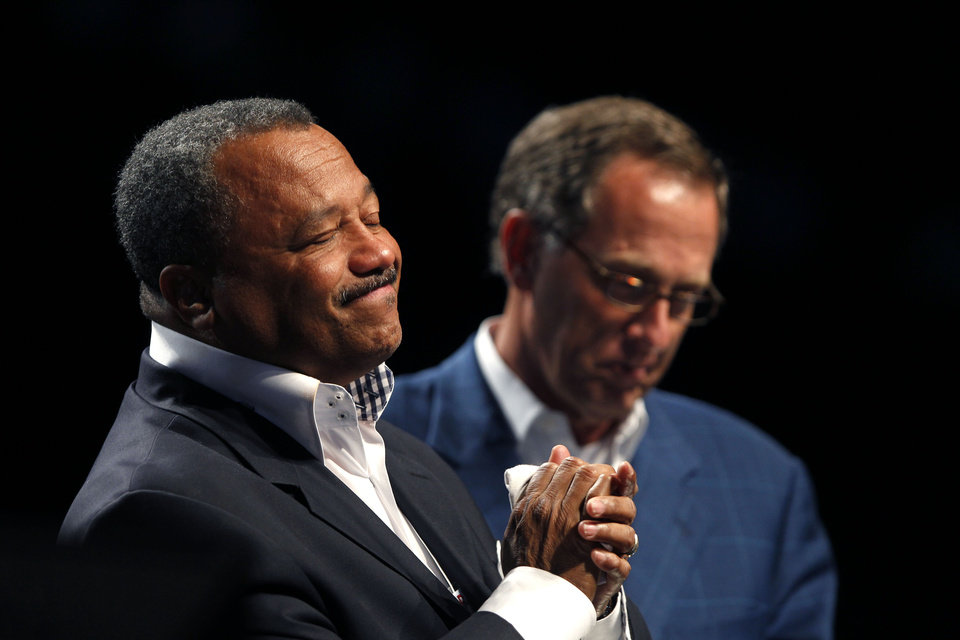 In this Tuesday, June 19, 2012 photo, Fred Luter, pastor of the Franklin Avenue Baptist Church in New Orleans, left, reacts as he is elected president of the Southern Baptist Convention, at the convention in New Orleans, as current president Bryant Wright stands at right. Luter is the first African-American to be elected president of the nation's largest Protestant denomination. Luter's election as president of the Southern Baptist Convention is one of the top Tennessee stories for 2012. (AP Photo/Gerald Herbert)