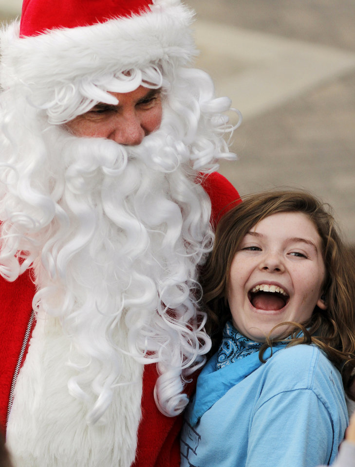 Savannah Schlegel, 12, Oklahoma City, smiles while having her photo made with the Segway Santa during the OneMain Financial Lights the Bricktown Canal event, which is part of Downtown in December in Oklahoma City Saturday, November 19, 2011. Photo by Doug Hoke, The Oklahoman