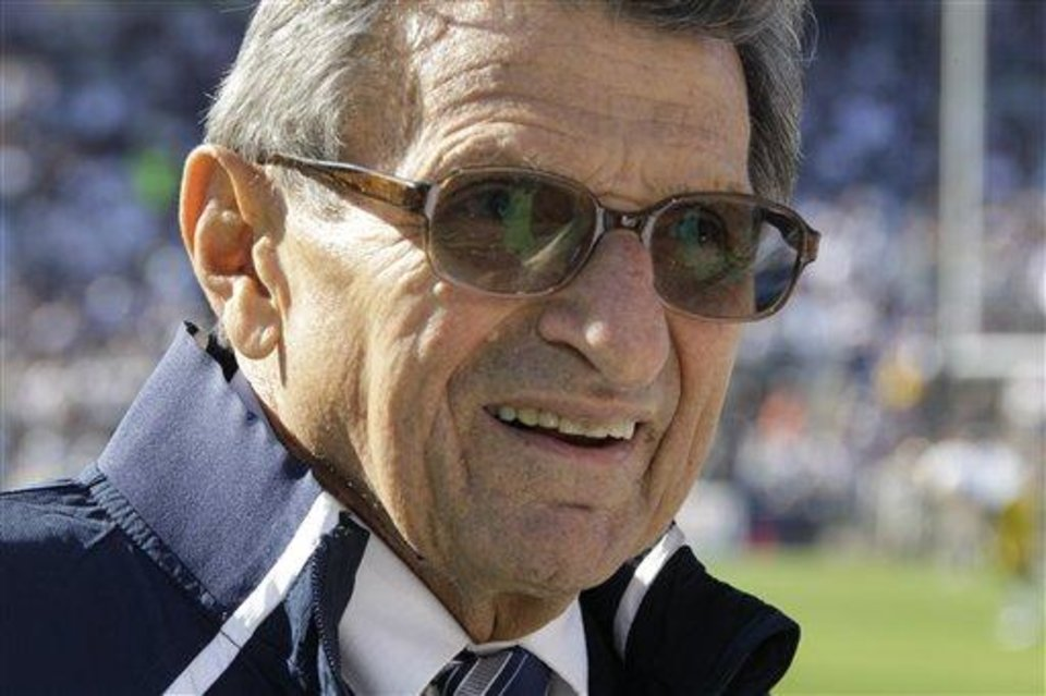 Photo - In this Oct. 8, 2011 file photo Penn St. head coach Joe Paterno walks onto the field for pre-game warm ups before a NCAA college football game against Iowa n State College, Pa., Saturday, Oct. 8, 2011. Penn State won 13-3, leaving them 5-1 on the season. (AP Photo/Gene Puskar)