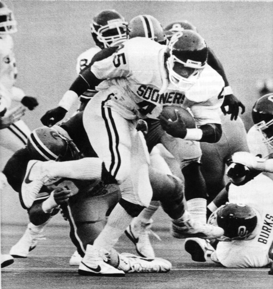 "FOOTBALL OU UNIVERSITY OF OKLAHOMA 1984 03: Caption reads ""Oklahoma's Lydell Carr skips out of tackle last Saturday en route to a 137-yard performance against Pittsburgh."" Photographer unknown. Date photo was taken unknown. Photo was published in The Daily Oklahoman 9-22-1984."