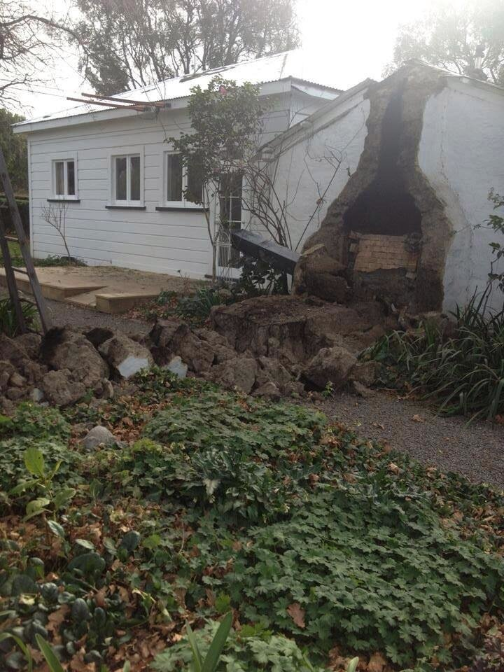 Photo - A part of the house wall was damaged in the small South Island town of Seddon after a magnitude-6.5 earthquake hit in the upper South Island of New Zealand, Friday, Aug. 16, 2013. Strong earthquakes shook central New Zealand on Friday, damaging homes, destroying a bridge and sending office workers scrambling for cover in the capital. No serious injuries have been reported. (AP Photo/Bejon Haswell, NZ Herald) NEW ZEALAND OUT, AUSTRALIA OUT