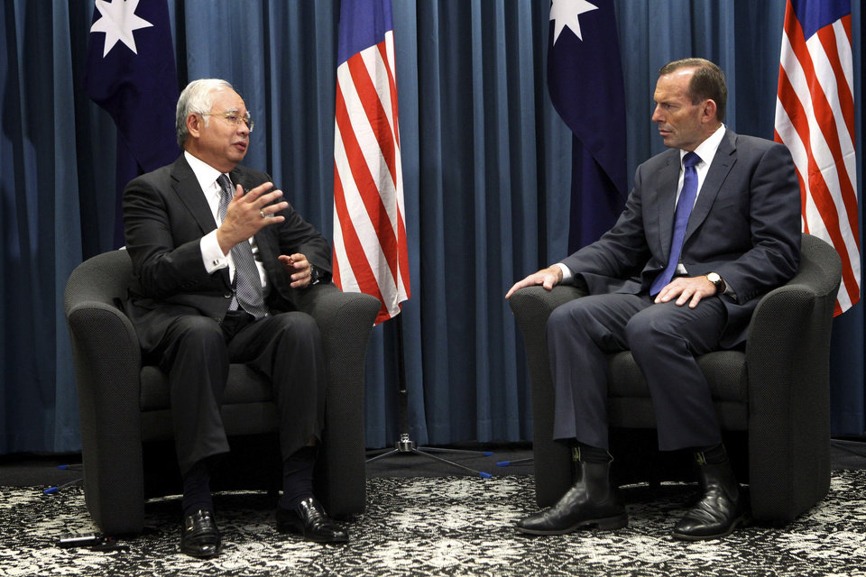 """Photo - Australian Prime Minister Tony Abbott, right, and Malaysian Prime Minister Najib Razak talk during their meeting at the Commonwealth Parliament Offices in Perth, Australia, Thursday, April 3, 2014. Abbott, whose country is coordinating the current search effort, spoke of """"very credible leads"""" and """"increasing hope"""" a day before Najib's announcement. But on Thursday he said the search has become """"the most difficult in human history."""" (AP Photo/Richard Wainwright, Pool)"""
