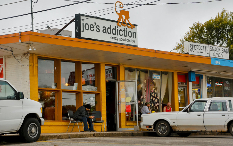 Photo - Customers sit outside of Joe's Addiction coffee shop in Valley Brook.The shop is said to cater to convicted felons and the homeless.  CHRIS LANDSBERGER - The Oklahoman
