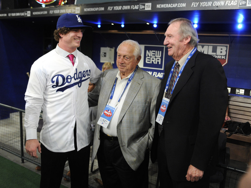Photo - Pitcher Grant Holmes, left,  from Conway High School in South Carolina talks with Hall of Famers Tommy Lasorda and Charlie Hough, right, at the 2014 MLB baseball draft Thursday, June 5, 2014, in Secaucus, N.J. Holmes was selected by the Los Angeles Dodgers with the 22nd pick in the first round. (AP Photo/Bill Kostroun)