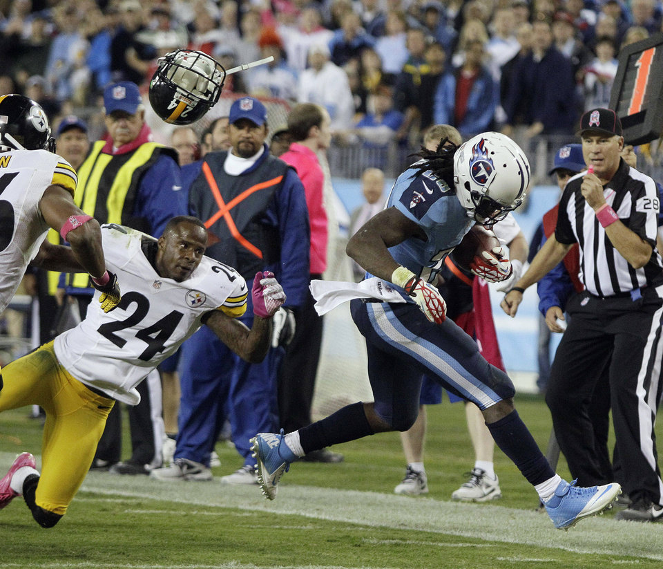 Pittsburgh Steelers cornerback Ike Taylor (24) loses his helmet as he chases Tennessee Titans running back Chris Johnson (28) out of bounds during the second half of an NFL football game Thursday, Oct. 11, 2012, in Nashville, Tenn. (AP Photo/Wade Payne)