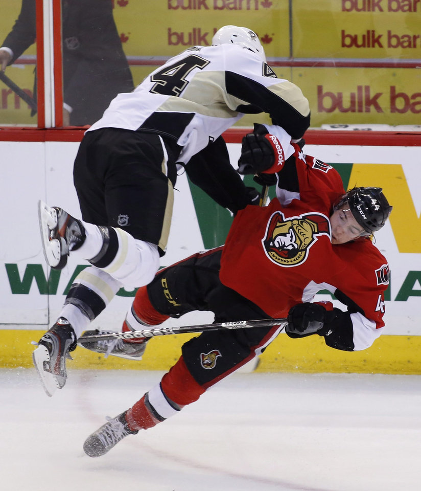 Photo - Pittsburgh Penguins Brooks Orpik, left, and Ottawa Senators Jean-Gabriel Pageau collide during the third period of game four of their Stanley Cup Eastern Conference semi-final NHL hockey game at Scotiabank Place in Ottawa on Sunday, May 19, 2013. (AP Photo/The Canadian Press, Patrick Doyle)