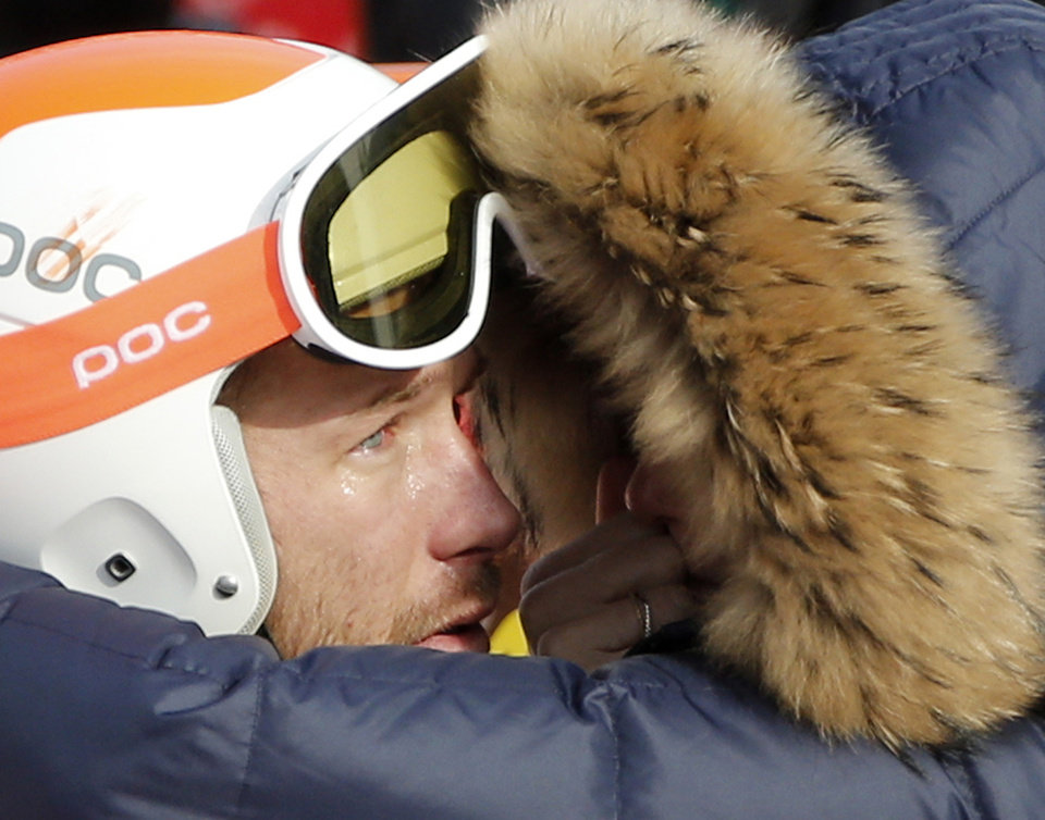Photo - Men's super-G joint bronze medal winner Bode Miller of the United States is consoled by his wife, Morgan, at the Sochi 2014 Winter Olympics, Sunday, Feb. 16, 2014, in Krasnaya Polyana, Russia. (AP Photo/Christophe Ena)