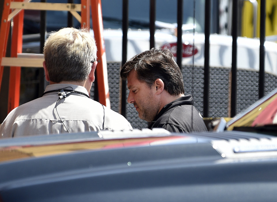 Photo - NASCAR auto racing driver Tony Stewart, right, arrives for a news conference at Atlanta Motor Speedway in Hampton, Ga., Friday, Aug. 29, 2014. Stewart says the death of Kevin Ward Jr. will