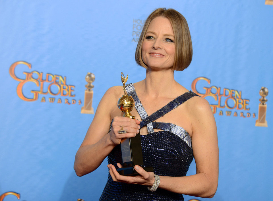 Jodie Foster poses with the Cecile B. DeMille Award for outstanding contribution to the entertainment field backstage at the 70th Annual Golden Globe Awards at the Beverly Hilton Hotel on Sunday in Beverly Hills, Calif. PHOTO BY JORDAN STRAUSS/INVISION/AP) <strong>Jordan Strauss - Jordan Strauss/Invision/AP</strong>