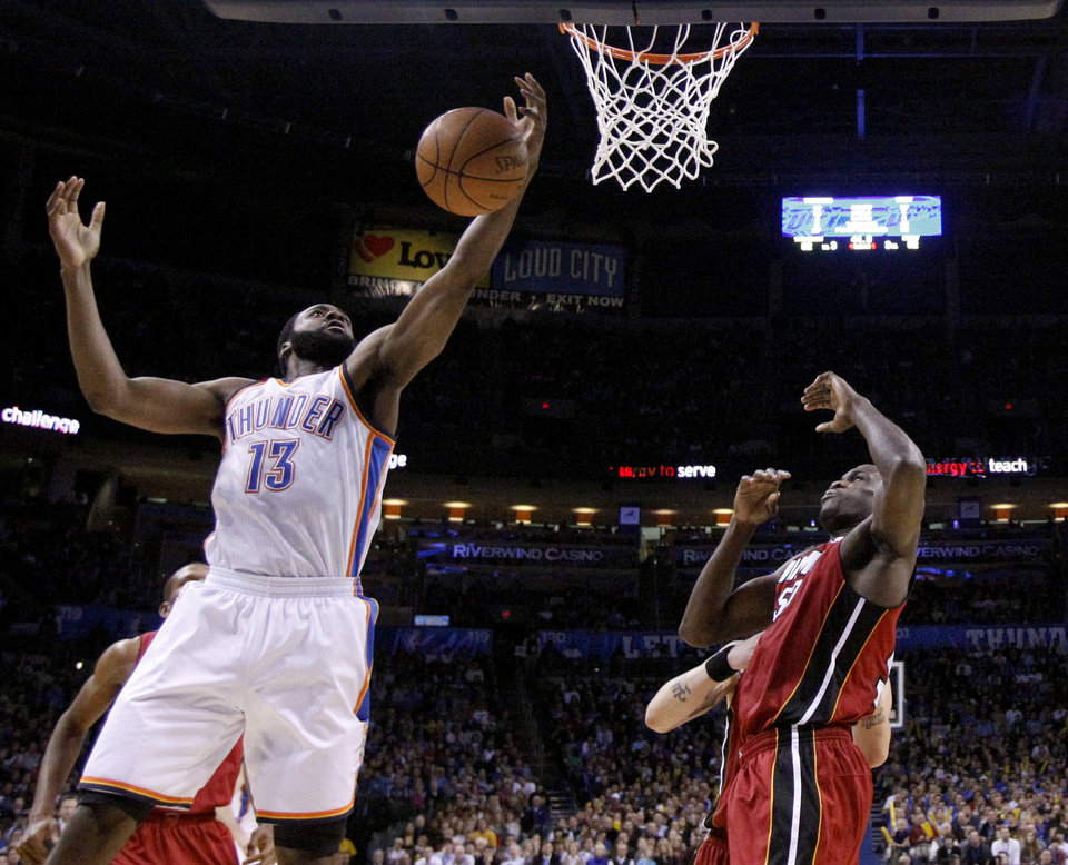Photo - Oklahoma City's James Harden (13) shoots as Miami's Joel Anthony (50) defends during the NBA basketball game between Oklahoma City and Miami at the OKC Arena in Oklahoma City, Thursday, Jan. 30, 2011. Photo by Sarah Phipps, The Oklahoman