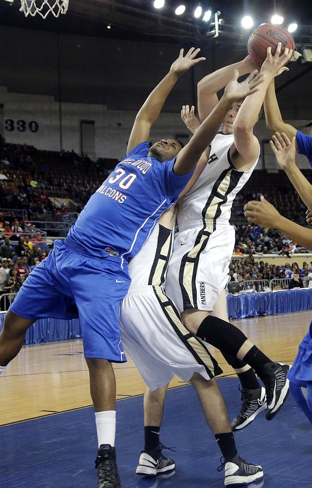 Photo - Millwood's Emmanuel Cole (30) and Okemah's Austin Guinn (35) battle for a rebound during the state high school basketball tournament Class 3A boys championship game between Millwood High School and Okemah High School at the State Fair Arena on Saturday, March 9, 2013, in Oklahoma City, Okla. Photo by Chris Landsberger, The Oklahoman