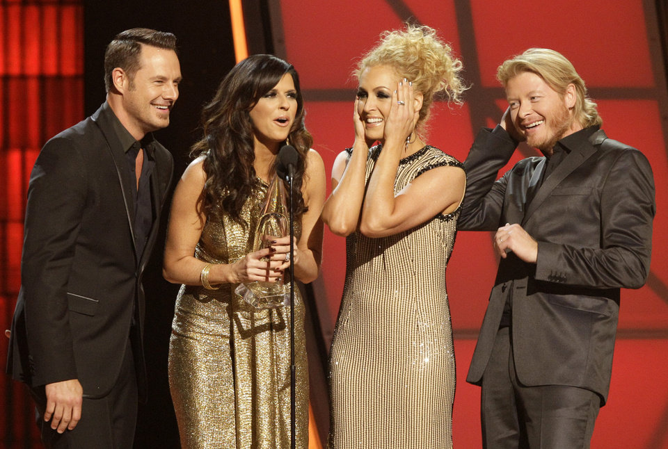 Photo -   Musical group Little Big Town, from left, Jimi Westbrook, Karen Fairchild, Kimberly Schlapman and Phillip Sweet, accept the award for single of the year for