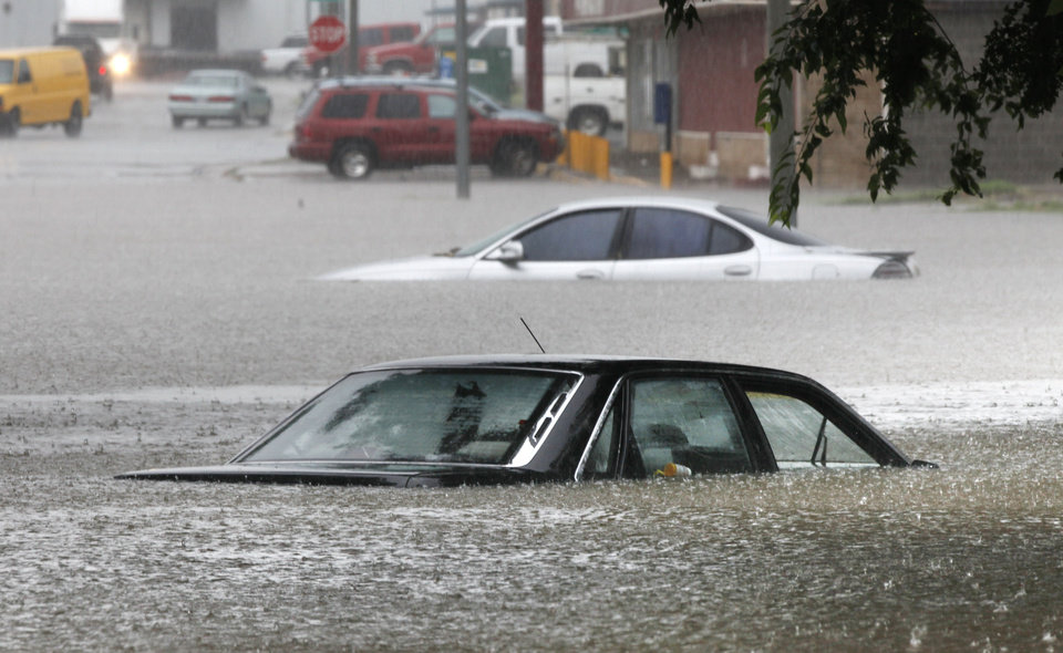 Cars are stalled in water up to their windows on SW 14th in Oklahoma City, OK, after heavy rains caused widespread flooding in the metro, Monday, June 14, 2010. By Paul Hellstern, The Oklahoman