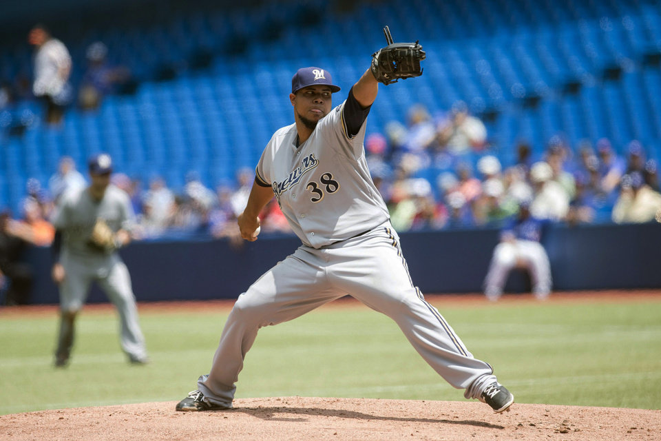 Photo - Milwaukee Brewers starting pitcher Wily Peralta works against the Toronto Blue Jays during first inning interleague baseball action in Toronto on Wednesday July 2 , 2014. (AP Photo/The Canadian Press, Chris Young)