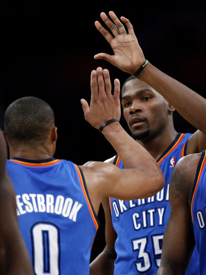 Oklahoma City's Russell Westbrook (0) and Kevin Durant (35) celebrate during Game 3 in the second round of the NBA basketball playoffs between the L.A. Lakers and the Oklahoma City Thunder at the Staples Center in Los Angeles, Friday, May 18, 2012. Photo by Nate Billings, The Oklahoman