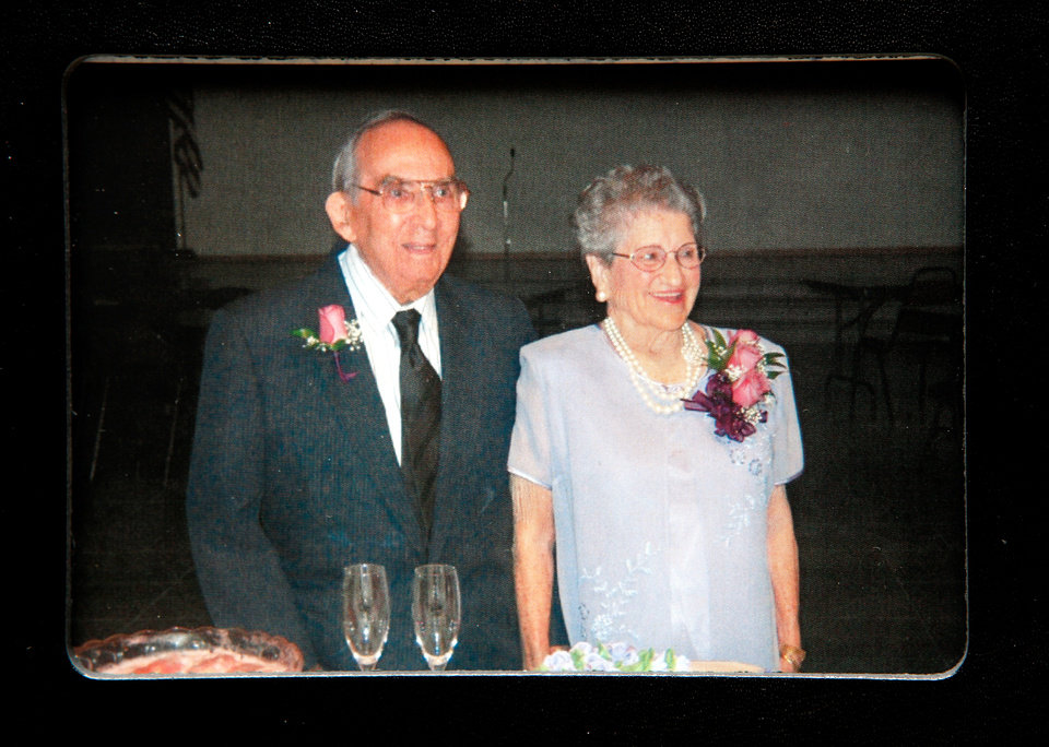 "Miguelito Miranda poses with his new bride on their wedding day. Miguelito and Olga Miranda married five months ago and are beginning a life together as husband and wife after a nearly 70 year separation.  Miguelito and Olga were neighbors in Puerto Rico and childhood sweethearts, described by both as the other's ""first love.'   Both married other people and their lives took them in different directions; Olga married a serviceman and  came to America while Miguelito married a woman and became a famous  band leader of a Latin orchestra,  In later years, their spouses died, leaving them both alone and lonely.  Miguelioto began a search to find his first love and he proposed to her on her 90th birthday.  The couple was married in September, 2011. They are photographed in their home in Del City on Monday, Feb. 13, 2012,