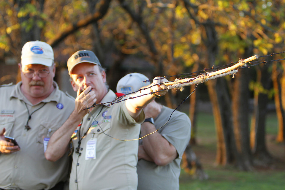 Photo - BOY SCOUTS: Mark Hamblin and Doug Cook with the Radio Scouter Group tries to contact the International Space Station with a barb wire antenna and a 5-watt radio during the 54th Jamboree-On-The -Air at  John Nichols Scout Ranch, Saturday, October 15, 2011.   Photo by David McDaniel, The Oklahoman  ORG XMIT: KOD